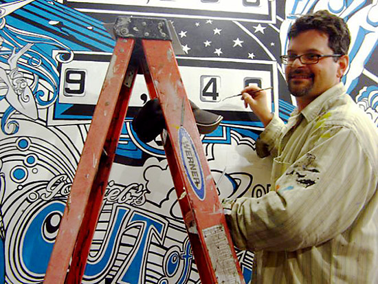 Artist Eric Kos as he develops his Gottlieb Out of Sight mural. PPM Archives