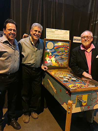Michael Schiess, PPM Founder, Larry Zartarian, PPM Board President and Gordo admire the show's signature game