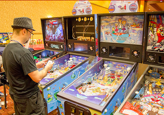 Charlie from Spooky Pinball sets up the two The Jetsons pinballs along with a Rob Zombie and Domino's