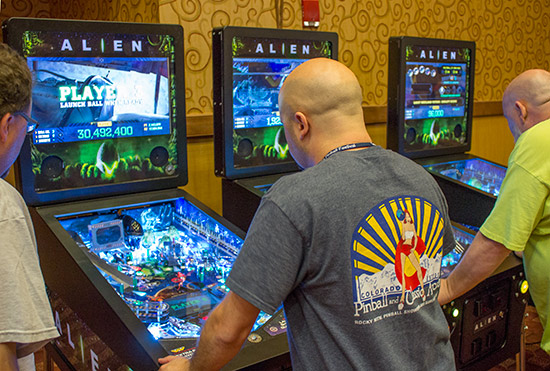 The three Alien Pinball machines in the show hall