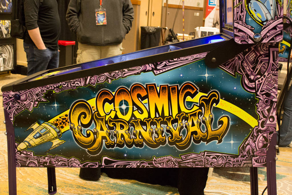 The Cosmic Carnival cabinet art