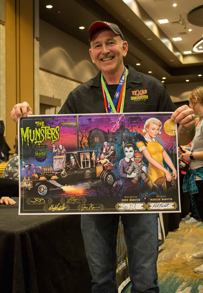 A signed commemorative poster with the happy owner