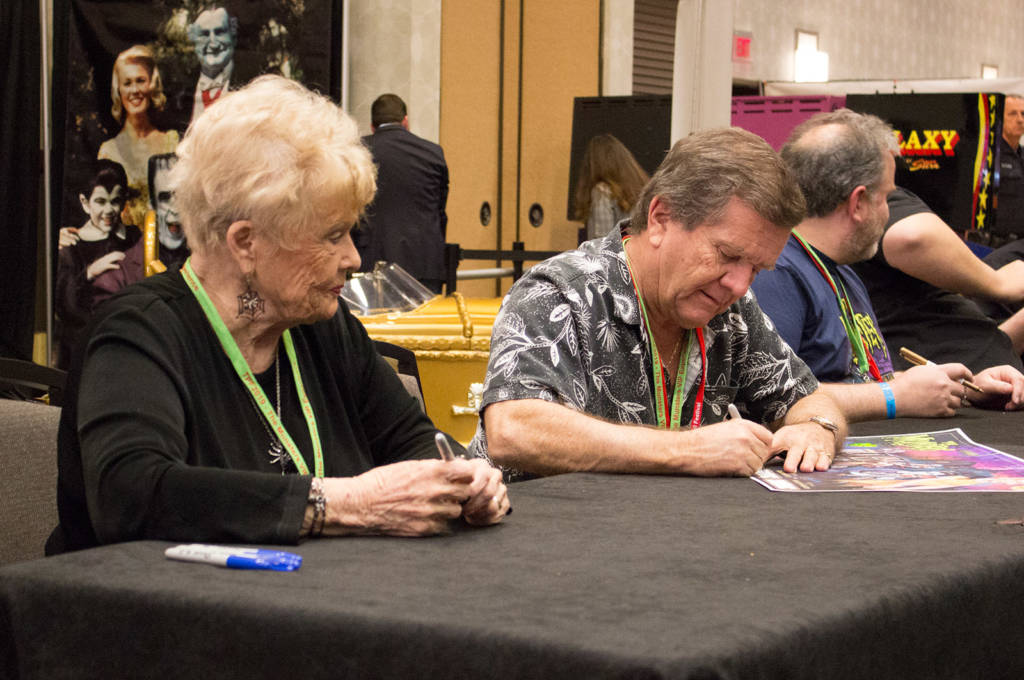 Pat Priest and Butch Patrick signing posters