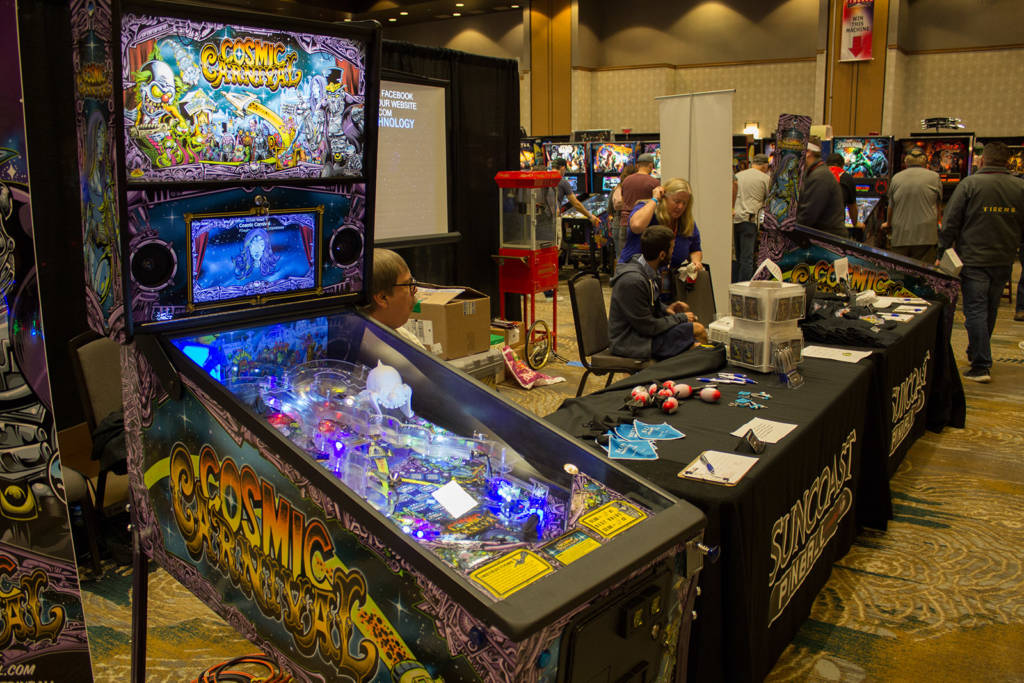 Suncoast Pinball had two Cosmic Carnival demonstration machines plus assorted branded apparel