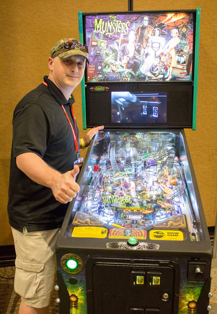 Grand Prize Draw winner, Michael Jolls, with his prize of a The Munsters pinball