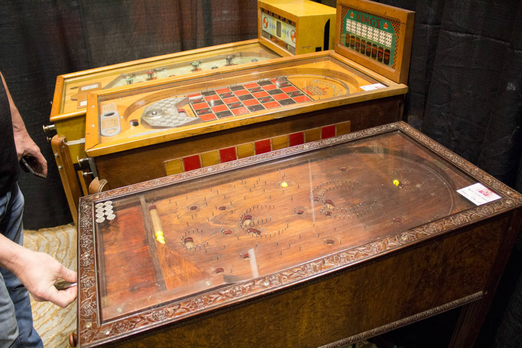 A full-size bagatelle alongside Kings and Bumper games