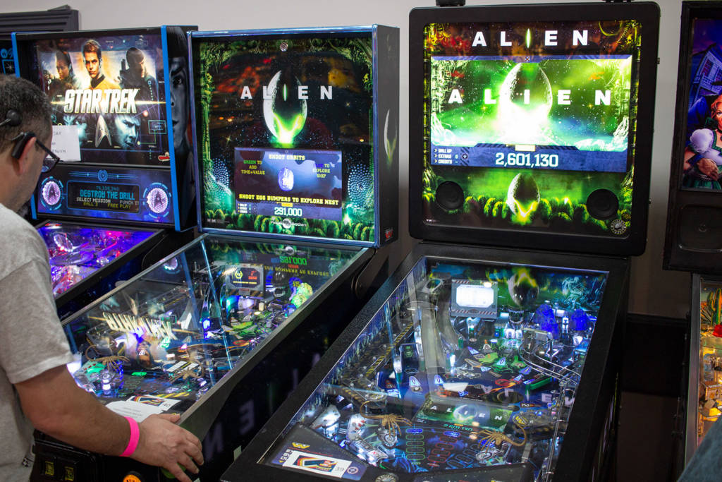 A Pinball Brothers Alien next to a Heighway Pinball Alien