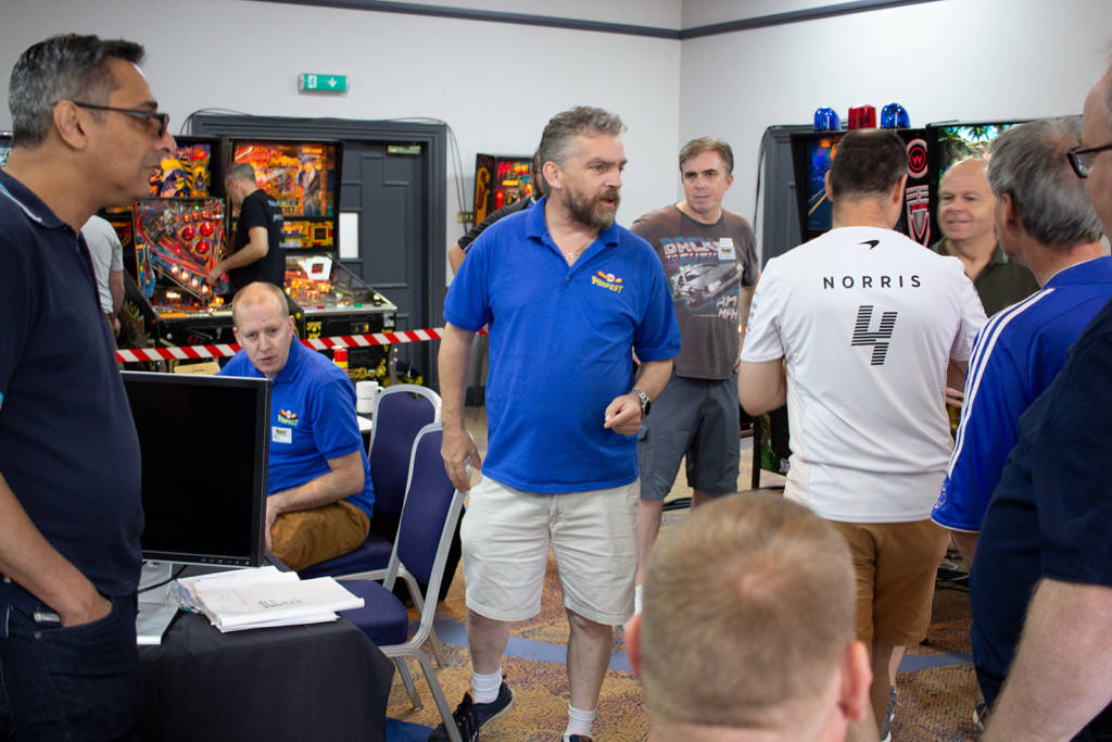 UKPinfest Battle co-organiser Wayne Johns assigns players to their pre-selected machines to start the play-offs