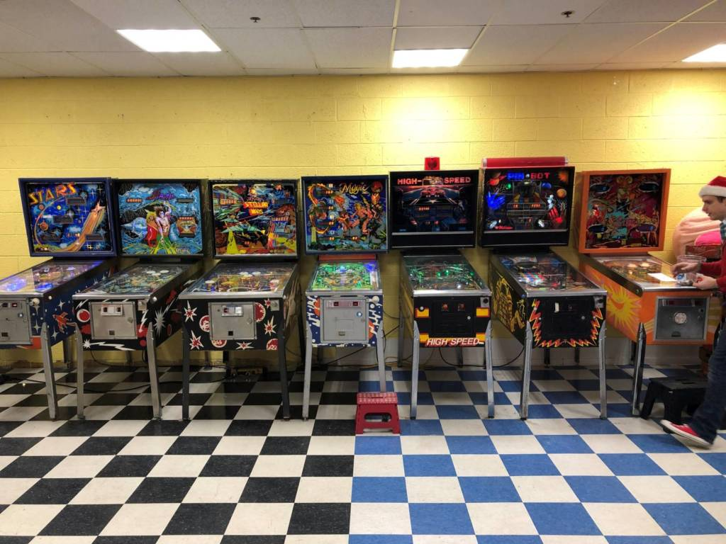 Seven pinball games along the first half way down the left side
