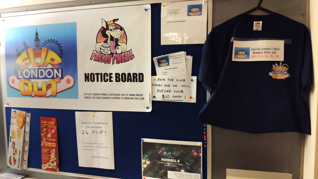 The club noticeboard promoting upcoming events, merchandise for sale and local food outlets