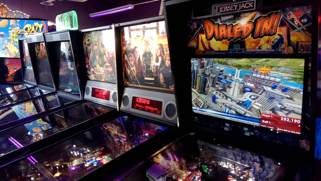 The first row of six pinball machines