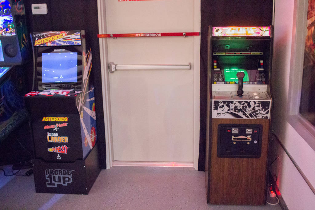 A multi-game cabinet and a Gorf sit next to the Kosmic Khaos cabinet