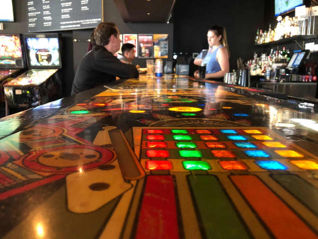 An actual lit pinball playfield bar-top